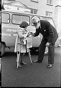 Entertainer Noel Purcell buys a flag from a young fund-raiser, Patricia Ferguson in a 'Help the Handicapped' campaign organized by the Central Remedial Clinic. .30.06.1963