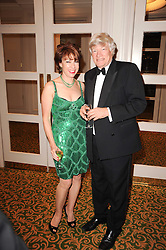 GEOFFREY ROBERTSON and KATHY LETTE  at a gala dinner in celebration of 80 years since the first Foyles Literary Luncheon, held in The Ball Room, Grosvenor House Hotel, Park Lane, London on 21st October 2010.
