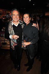 STEPHEN & FLO BAYLEY at a party to celebrate 25 years of the David Linley store , 60 Pimlico Road, London on 16th November 2010.
