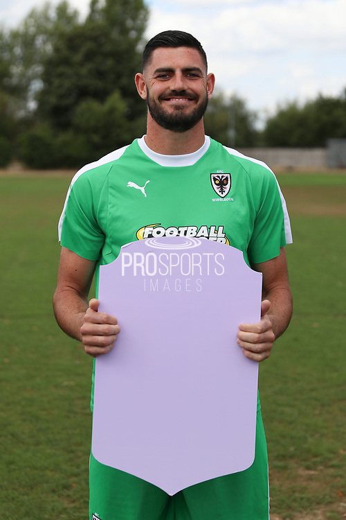 AFC Wimbledon goalkeeper Tom King (1) holding Fifa sign during the AFC Wimbledon 2018/19 official photocall at the Kings Sports Ground, New Malden, United Kingdom on 31 July 2018. Picture by Matthew Redman.