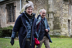 © Licensed to London News Pictures. 28/01/2018. Sonning, UK. British prime minister THERESA MAY attends a morning church service with her husband PHILIP MAY - near her constituency home. Photo credit: Peter Macdiarmid/LNP