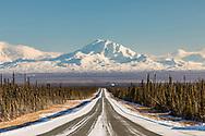 Mt. Sanford, Mt. Drum, and Mt. Wrangell loom large over Glennallen in Interior Alaska. Winter. Afternoon.