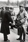 German Chancellor Adolph Hitler greeting  President Paul von Hindenberg, 1933.