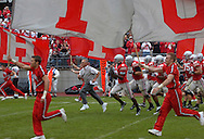 MORNING JOURNAL/DAVID RICHARD.Ohio State head coach Jim Tressel leads the top-ranked Buckeyes onto the field yesterday against Northern Illinois in Columbus.
