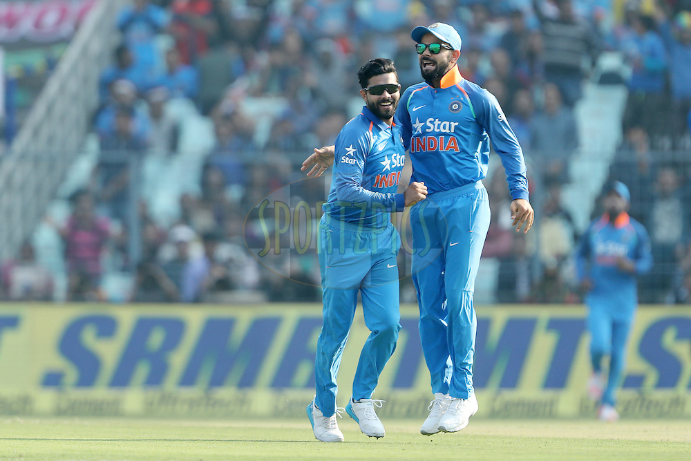 Ravindra Jadeja of India celebrates the wicket of  Sam Billings of England  with Virat Kohli Captain of India during the third One Day International (ODI) between India and England  held at Eden Gardens in Kolkata on the 22nd January 2017<br /> <br /> Photo by: Ron Gaunt/ BCCI/ SPORTZPICS