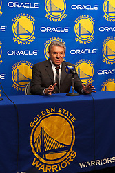 Mar 16, 2012; Oakland, CA, USA; Golden State Warriors general manager Larry Riley introduces center Andrew Bogut (not pictured) before the game against the Milwaukee Bucks at Oracle Arena. Mandatory Credit: Jason O. Watson-US PRESSWIRE