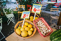 """NAPLES, ITALY - 13 JULY 2017: Lemons, garlic and a watermelon are seen here at """"In Tabula"""", a cafe and lunch restaurant in Piazza Bellini in Naples, Italy, on July 13th 2017."""