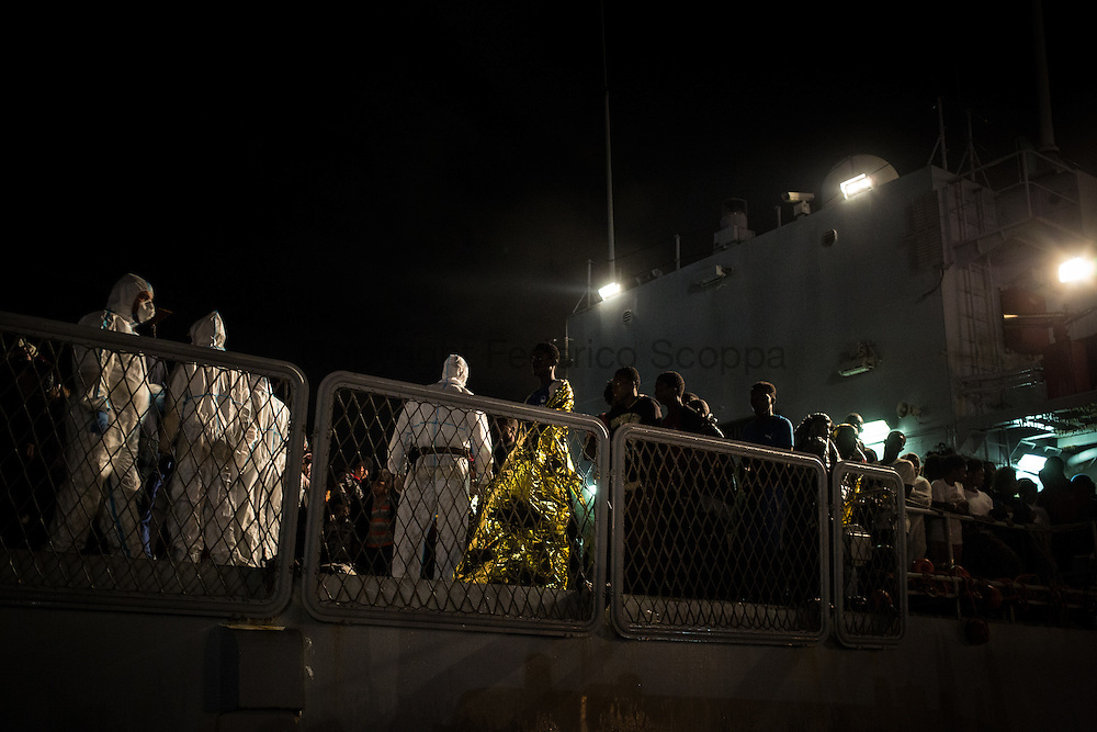 A italian Navy vessel carring hundreds of migrants in the Catania harbor