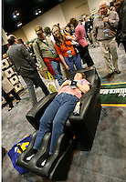 Berkshire Hathaway shareholder Laureen Link tries out a massage chair at the company trade show during the BH annual meeting in Omaha, Nebraska April 30, 2011. Dozens of BH companies were selling products made by BH companies at discounts for the shareholders.  This chair, normally $5,000 was discounted to $3,800.  REUTERS/Rick Wilking  (UNITED STATES)