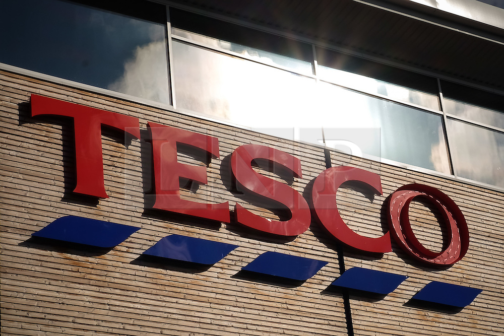 © Licensed to London News Pictures. 05/10/2016. Portsmouth, Hampshire, UK.  A general view of a Tesco sign in Portsmouth this morning. Tesco PLC, Britain's largest supermarket chain has announced that like-for-like sales had grown in the first half of its financial year. The results come following increased competition in the market from budget supermarkets such as Aldi & Lidl. Photo credit: Rob Arnold/LNP