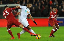 Jordan Ayew of Swansea City jostles with Emre Can of Liverpool- Mandatory by-line: Nizaam Jones/JMP - 22/01/2018 - FOOTBALL - Liberty Stadium- Swansea, Wales - Swansea City v Liverpool - Premier League