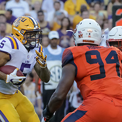 Sep 23, 2017; Baton Rouge, LA, USA; LSU Tigers running back Derrius Guice (5) runs against the Syracuse Orange during the first quarter of a game at Tiger Stadium. Mandatory Credit: Derick E. Hingle-USA TODAY Sports