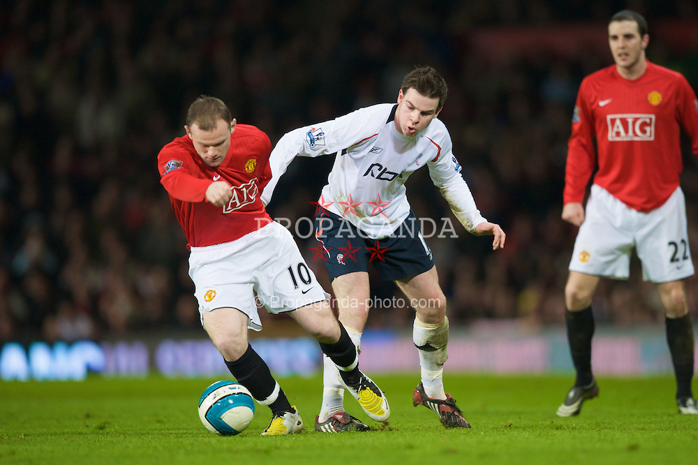 MANCHESTER, ENGLAND - Wednesday, March 19, 2008: Manchester United's Wayne Rooney and Bolton Wanderers' Danny Guthrie during the Premiership match at Old Trafford. (Photo by David Rawcliffe/Propaganda)