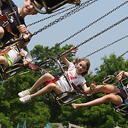 Young children enjoy a swing ride during the Weston Fair, Weston, Connecticut, USA. 28th May 2012. Photo Tim Clayton