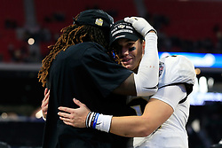 UCF Knights linebacker Shaquem Griffin (18) celebrates with quarterback McKenzie Milton (10) after beating the Auburn Tigers during the 2018 Chick-fil-A Peach Bowl NCAA football game on Monday, January 1, 2018 in Atlanta. The UCF Knights won 34-27. (Paul Abell / Abell Images for the Chick-fil-A Peach Bowl)