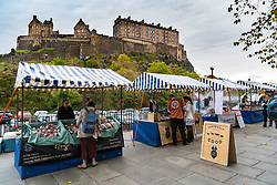 View of Weekend Farmers Market at foot of Edinburgh Castle in Scotland , United Kingdom.