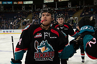 KELOWNA, CANADA - DECEMBER 5: Devin Steffler #4 of the Kelowna Rockets fist bumps players on the bench to celebrate a goal against the Tri-City Americans on December 5, 2018 at Prospera Place in Kelowna, British Columbia, Canada.  (Photo by Marissa Baecker/Shoot the Breeze)