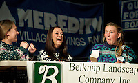 """The """"Ugly Sweaters"""" team of GHS students Lauren Pereira, Brianna Bowen and Katherine Rice are surprised as they make it through the third round of the annual LRSF Spelling Bee and Laconia High School Thursday evening.  (Karen Bobotas/for the Laconia Daily Sun)"""
