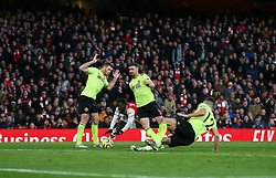 Nicolas Pepe of Arsenal goes down under a challenge from Enda Stevens of Sheffield United - Mandatory by-line: Arron Gent/JMP - 18/01/2020 - FOOTBALL - Emirates Stadium - London, England - Arsenal v Sheffield United - Premier League