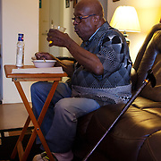 John E. Johnson, who is not eligible for medicaid, receives services for 12 hours per week through Illinois&rsquo; Community Care Program. Johnson worries his services will be cut if the state transition seniors like him to a new program. The state employs Reggie Griffin to help Johnson with daily chores so he is able to stay in his home, as opposed to going to an nursing home. <br /> Photography by Jose More