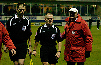 Photo: Daniel Hambury.<br />Luton Town v Cardiff City. Coca Cola Championship. 14/02/2006.<br />Referee Andy Woolmer (centre) and assistant are escorted off the pitch by a steward.