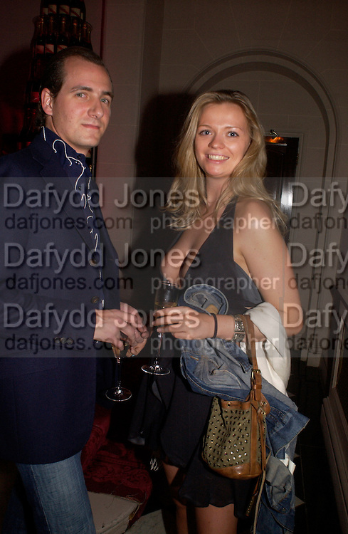 Matias Santa Cruz and Cecilia Matmore, Party at Fifty, St. James St. following the Formula  1 showcase where drivers raced down Regent St. in central London. 6 July 2004. SUPPLIED FOR ONE-TIME USE ONLY-DO NOT ARCHIVE. © Copyright Photograph by Dafydd Jones 66 Stockwell Park Rd. London SW9 0DA Tel 020 7733 0108 www.dafjones.com