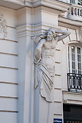 Statue and architectural details on the facade of a building in Museumstrasse District 7, Vienna, Austria