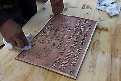 August 16, 2017 - San Diego, California, U.S. - (File Photo) -  A plaque honoring the President of the Confederacy Jefferson Davis was removed from Horton Plaza Park in downtown San Diego Wednesday morning. PICTURED: April 29, 2016 - San Diego, California, U.S. - A worker at Horton Plaza polished a bronze plaque honoring Jefferson Davis, the president of the confederacy, that was being reinstalled in the tile walkway at the remodeled Horton Plaza, in preparation for the reopening of the Plaza. (Credit Image: © John Gibbins/San Diego Union-Tribune via ZUMA Wire)