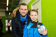 Matchday mascot with Forest Green Rovers Christian Doidge(9) during the EFL Sky Bet League 2 match between Forest Green Rovers and Mansfield Town at the New Lawn, Forest Green, United Kingdom on 24 March 2018. Picture by Shane Healey.
