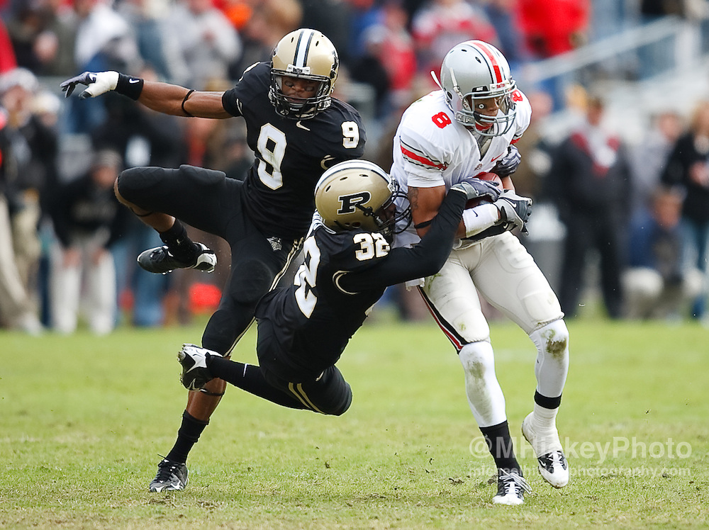 Ohio State wide receiver DeVier Posey is tackled by Purdue defenders during NCAA football action at Ross-Ade Stadium in West Lafayette, IN.
