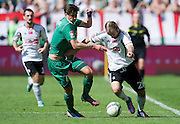 (R) Legia's Danijel Ljuboja fights for the ball with (L) Lechia's Jaroslaw Bieniuk during T-Mobile Extraleague soccer match between Legia Warsaw and Lechia Gdansk at Pepsi Arena in Warsaw, Poland...Poland, Warsaw, May 05, 2013..Picture also available in RAW (NEF) or TIFF format on special request...For editorial use only. Any commercial or promotional use requires permission...Photo by © Adam Nurkiewicz / Mediasport