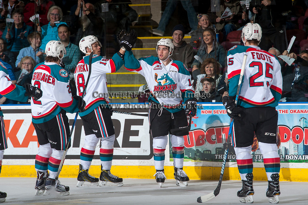 KELOWNA, CANADA - MARCH 10: Carsen Twarynski #18 high fives Dillon Dube #19 of the Kelowna Rockets after a first period goal against the Vancouver Giants on March 10, 2017 at Prospera Place in Kelowna, British Columbia, Canada.  (Photo by Marissa Baecker/Shoot the Breeze)  *** Local Caption ***