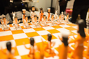 Brightly colored wooden chess pieces in the Mexican room.