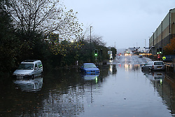 © Licensed to London News Pictures. 22/11/2016. Rotherham, UK. Abandoned cars are submerged on a flooded road in Rotherham, South Yorkshire, after a river broke it's banks last night. Storm Angus has brought heavy wind and rain to much of the UK this week with flooding seen all over. Photo credit : Ian Hinchliffe/LNP