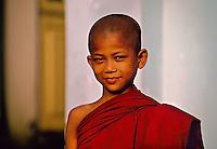 Young novice monk outside the Botataung Pagoda, Yangon (Rangoon), Burma (Myanmar)