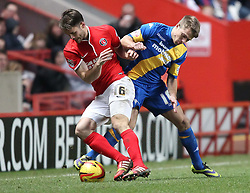 Charlton Athletic's Dorian Dervite tussles for the ball with Derby County's Jamie Ward - Photo mandatory by-line: Robin White/JMP - Tel: Mobile: 07966 386802 14/12/2013 - SPORT - Football - Charlton - The Valley - Charlton Athletic v Derby County - Sky Bet Championship