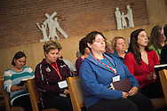 Deaconess Katie Willman bows her head during noon prayer at the Grace Place Deaconess retreat on Wednesday, Oct. 8, 2014, at the Mercy Conference and Retreat Center in Frontenac, Mo. LCMS Communications/Erik M. Lunsford