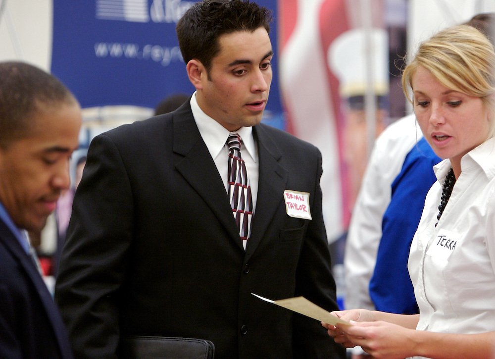 Ohio University student Brian Taylor, center, speaks with State Farm claim representatives Terra Woolard, right and Evanston Abair.during the career fair in the Baker University Center on Wednesday, October 3, 2007..photo by Kevin Riddell