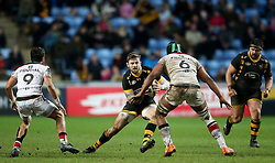 Wasps' Elliot Daly side steps Toulouse's Thierry Dusautoir to score their first try during the European Champions Cup, pool two match at the Ricoh Arena, Coventry.