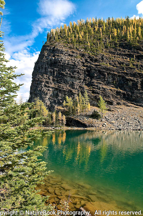 After a vigorous hike up the mountain, Lake Agnes rewards visitors with beautiful rock formations and trees in Banff National Park in Western Canada.