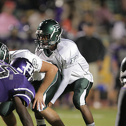07 November 2008:  Ponchatoula Green Wave QB Eldrid Palmer (#5) The Ponchatoula Green Wave defeated District 7-5A rival the Hammond Tornados 34-13 at Strawberry Stadium in Hammond, LA . The Green Wave with the win clinched a spot in the 2008 playoffs.