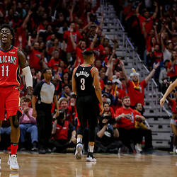 Apr 21, 2018; New Orleans, LA, USA; New Orleans Pelicans guard Jrue Holiday (11) reacts after a three point play during the second half in game four of the first round of the 2018 NBA Playoffs against the Portland Trail Blazers at the Smoothie King Center. Mandatory Credit: Derick E. Hingle-USA TODAY Sports