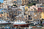 Fishing trawlers being repaired in dry dock at Sciacca Port with the town behind, south coast of Sicily, Italy