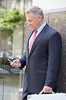 Businessman Dialing Cell Phone