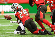 Carolina Panthers Quarterback Kyle Allen (7) is sacked by Tampa Bay Buccaneers Defensive Back Ryan Smith (29) during the International Series match between Tampa Bay Buccaneers and Carolina Panthers at Tottenham Hotspur Stadium, London, United Kingdom on 13 October 2019.