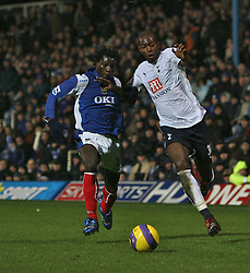 PORTSMOUTH, ENGLAND - MONDAY, JANUARY 1st, 2007: Benjani of Portsmouth clashes with Anthony Gardner of Tottenham Hotspur during the Premiership match at Fratton Park. (Pic by Chris Ratcliffe/Propaganda)