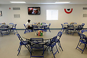 Target Logistics workers lodge dining hall. More commonly known as a &quot;mancamp&quot;, this lodge is just west of Tioga. The camps are constructed from prefabricated containers, and offer small clean functional rooms and good cafeteria food. This camp is the largest in the US and has a population of 1,053 and a 330m long corridor. They have a staff of 70 and consume between 40-60,000 lbs of food a week.<br /> <br /> Most workers here are employed by an oil services company and spend two weeks onsite, working15 hour days. they then get a week off to see their family. The pay makes it worthwhile as it is oftern double what they could get otherwise employed in the their professions.<br /> <br /> North Dakota oil boom. Based around the town of Williston, hydraulic fracturing, also known as 'fracking' has enabled a vast reserve of previously unobtainable oil to be accessed.