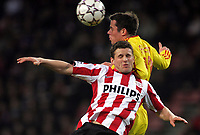 Photo: Paul Thomas.<br /> PSV Eindhoven v Liverpool. UEFA Champions League, Quarter Final, 1st Leg. 03/04/2007.<br /> <br /> Jamie Carragher (R) of Liverpool battles Jason Culina.