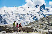 "Hike from Pontresina up Roseg Valley to Fuorcla Surlej for stunning views of Piz Bernina and Piz Rosegg, finishing at Corvatsch Mittelstation Murtel lift. Walking 14 km, we went up 1100 meters and down 150 m. Optionally shorten the hike to an easy 4 km via round trip lift. Pontresina is in Upper Engadine, in Graubünden (Grisons) canton, Switzerland, the Alps, Europe. The Swiss valley of Engadine translates as the ""garden of the En (or Inn) River"" (Engadin in German, Engiadina in Romansh, Engadina in Italian). For licensing options, please inquire."