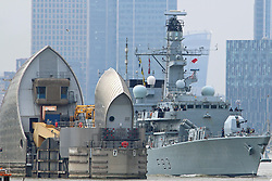 © Licensed to London News Pictures. 15/07/2015.  Woolwich, London. The Royal Navy frigate HMS St Albans seen on the river today leaving London after an 7 day visit. Type 23 vessel HMS St Albans was moored in West India Dock during her stay and passed London landmarks such as Canary Wharf, the O2, Thames Barrier and Woolwich ferry as she made her way down the Thames. Credit : Rob Powell/LNP